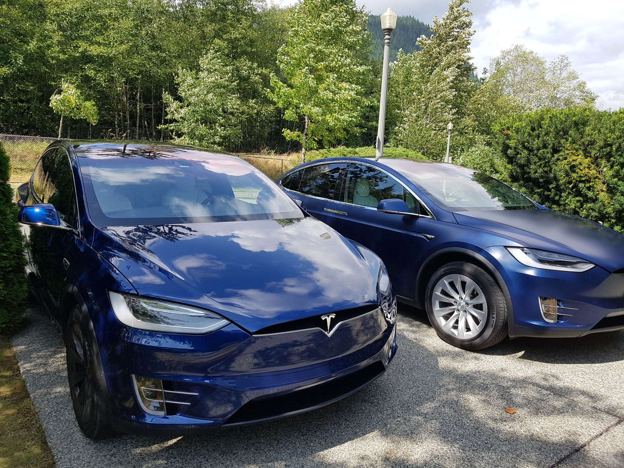 side by side tesla's one with matte finish one with shiny finish
