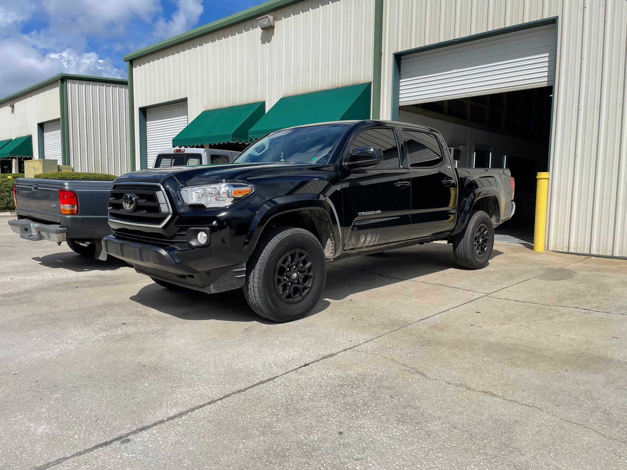 Black truck with tinted windows